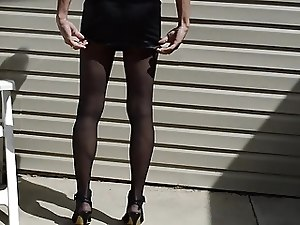 Mini Skirt, Black Pantyhose and High Heels